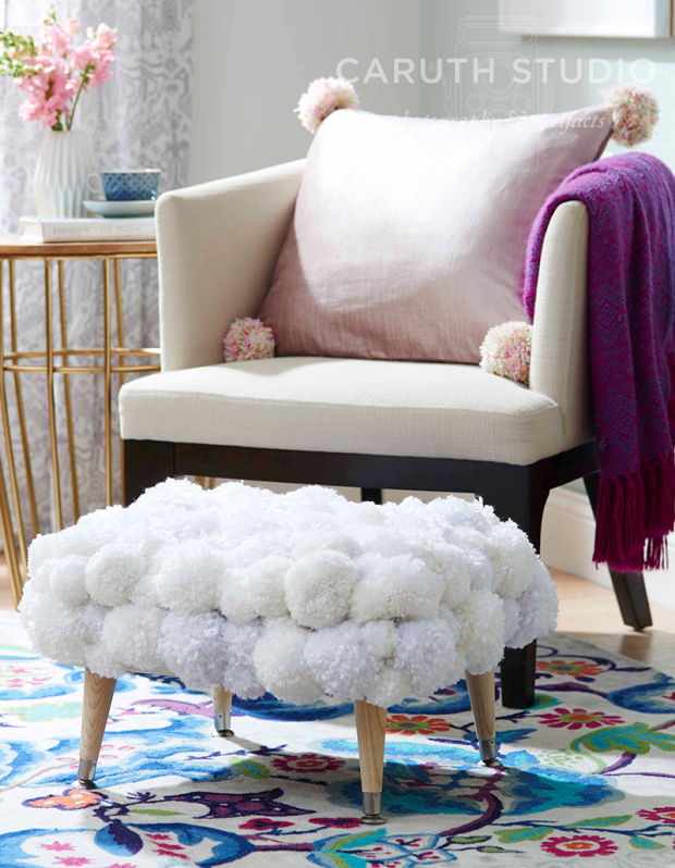 Chair with pom-pom ottoman detail