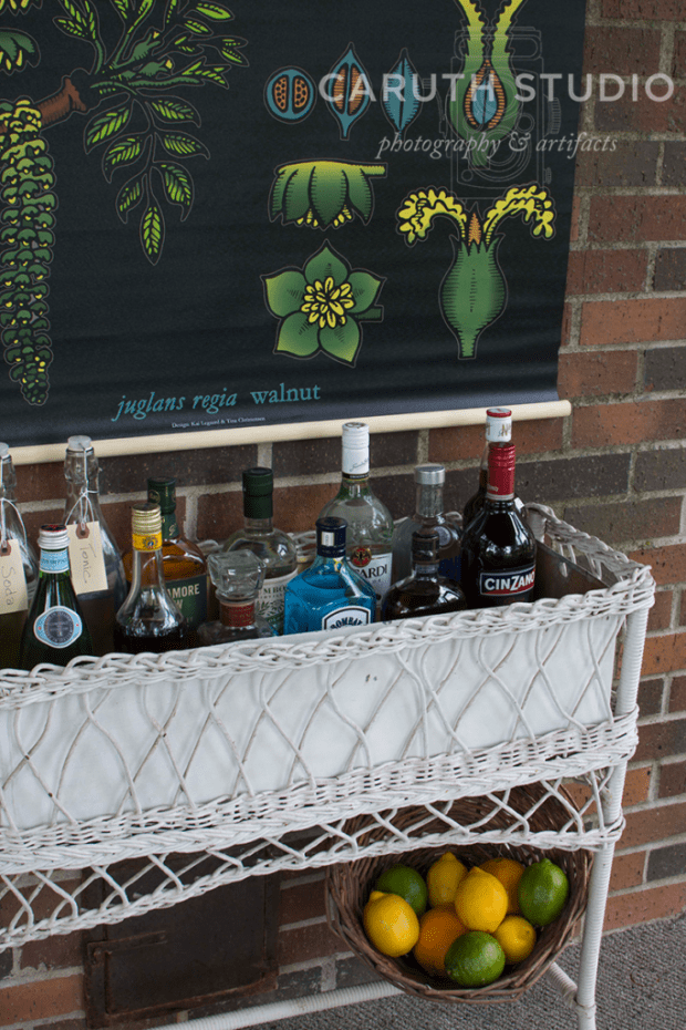 liquor filled wicker bar with botanical wall mural