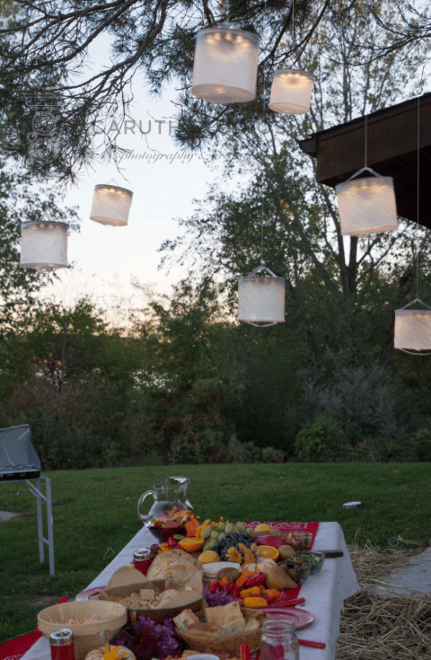 outdoor paper lanterns strung from the tree