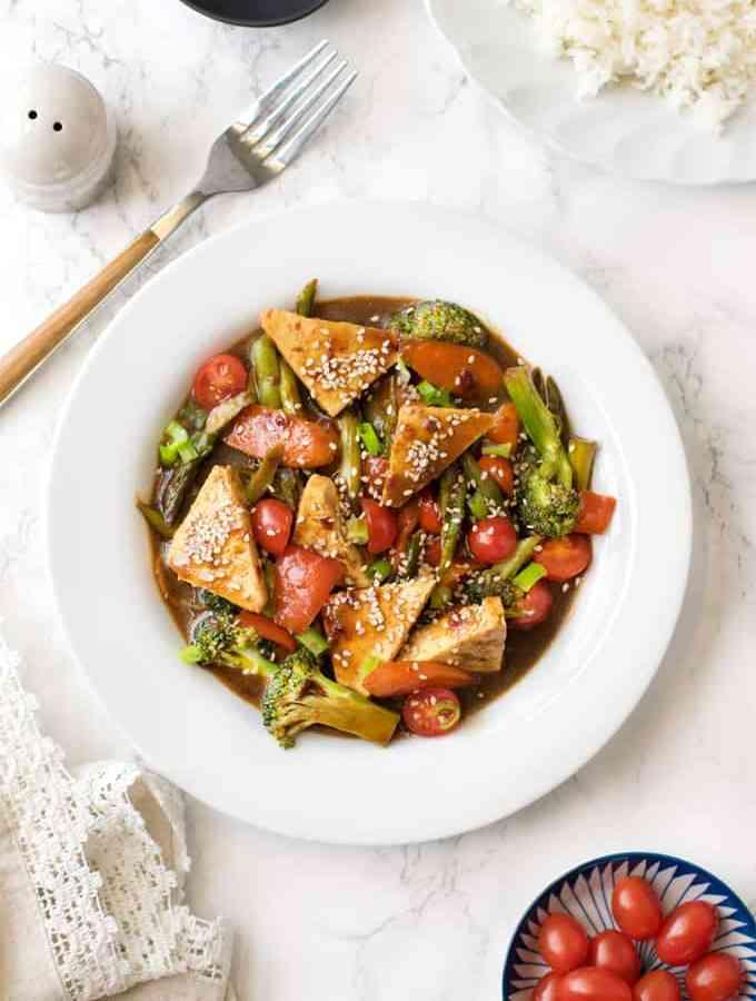 Vegan stir fry veggies and tofu in homemade hoisin sauce