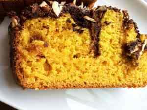Eggless mango chocolate cake with almond crunch