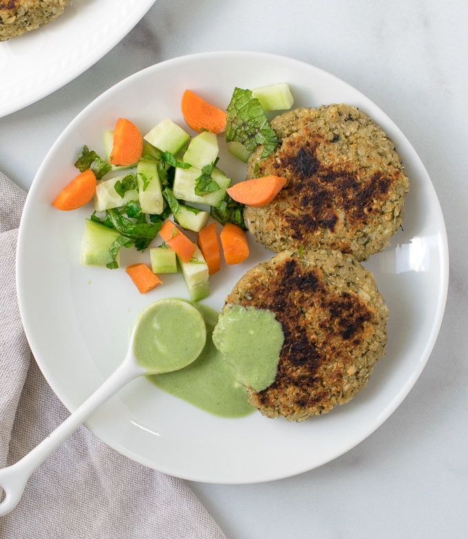 Quinoa paneer kababs with green dip on a white plate