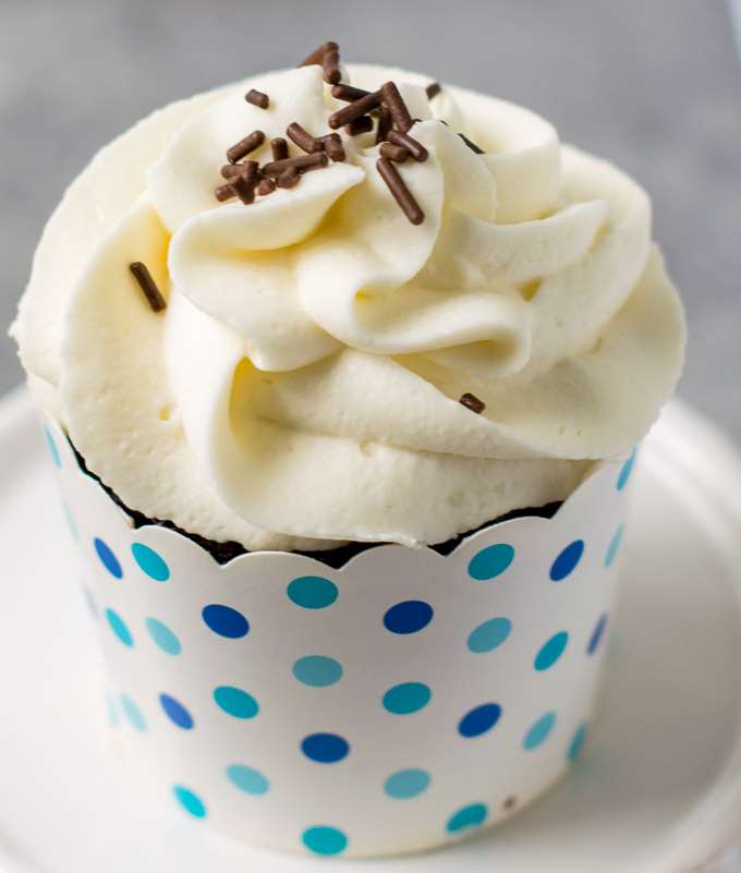 Cupcake with mascarpone frosting and sprinkles