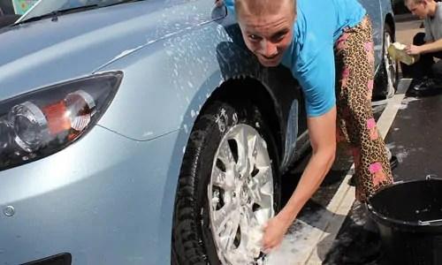 washing car on tarp