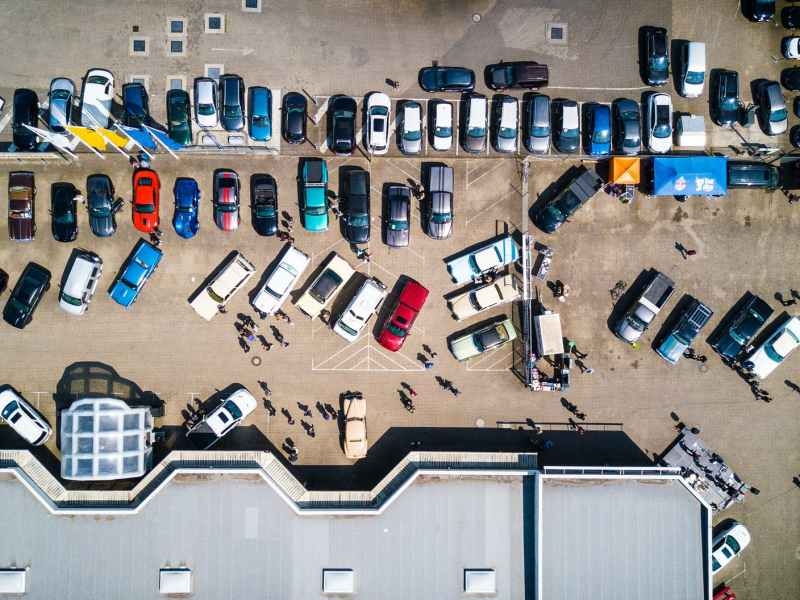 high angle photo of vehicles parked near building