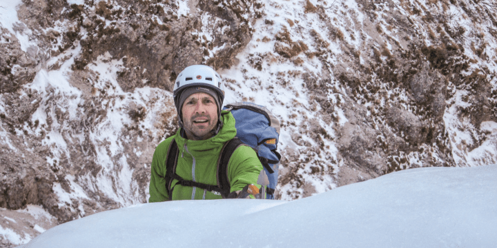 Jason Bailey high on Cascata Nevere in Val Corpassa on the flanks of Moiazza, a 5mm WI3+