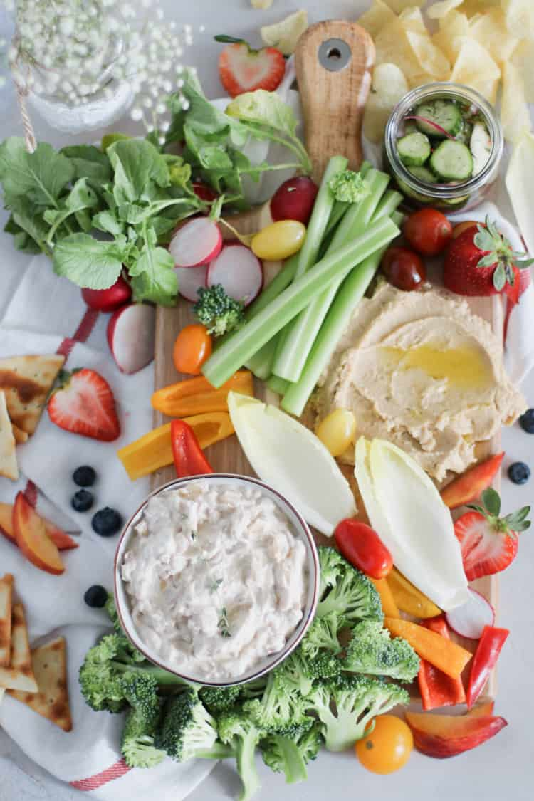 Summer Crudite Snack Board. Raw and fresh summer veggies, paired with your favorite dip is anything but boring - A Summer Crudité board is the perfect beginning to any weekend bbq!