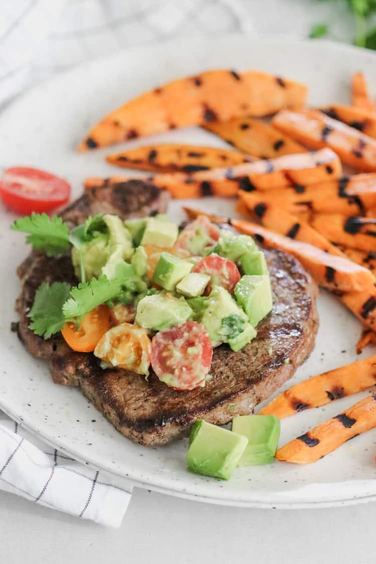 cumin rubbed sirloin steak with avocado salsa