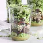 shredded brussels sprouts salad with bacon and dried figs