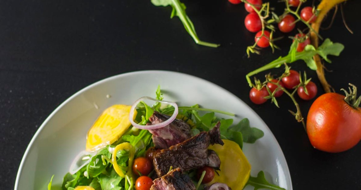 Plated Steak and Pan Roasted Tomato Salad with golden beets and arugula