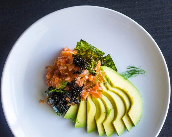 Overhead shot of Salmon Tartare with Fennel and Caviar on a plate
