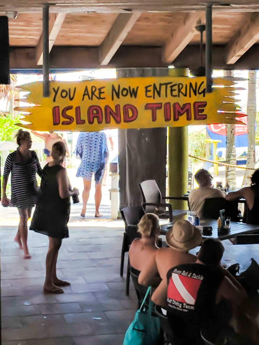 Plank with slogan you are now entering island time