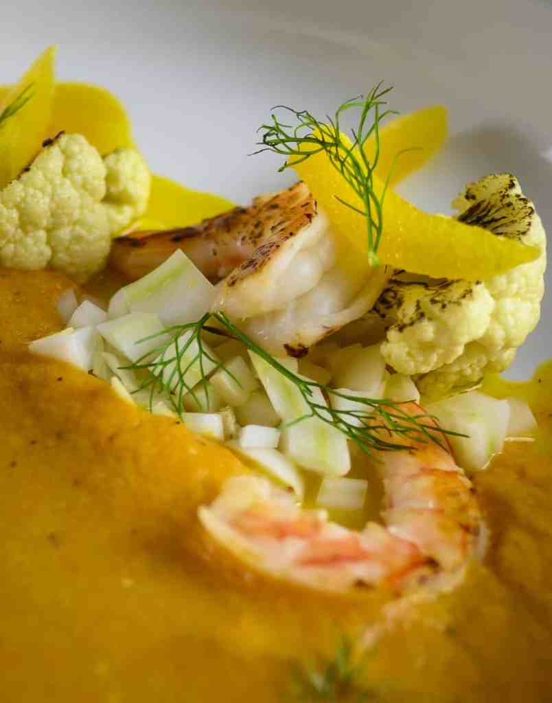 Close up shrimp and cauliflower on plate