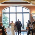 Couple walking down processional, Wedding Ceremonies and Receptions at Casa Larga Vineyards
