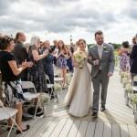 Husband and wife walking down aisle, Wedding Ceremonies and Receptions at Casa Larga Vineyards