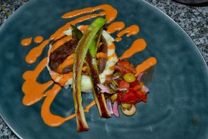 Sous Vide Lamb Loin, Lamb Fat Mashed Potatoes, Pickled Vegetables, Tomato-Black Olive Sauce