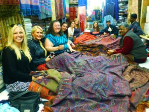 Our tour group sitting amongst the various scarves and blankets in Ganga Handlooms, a shop in the alleyways of Varanasi
