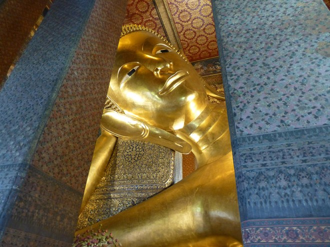 At Wat Pho, we visited the giant reclining Buddha. It's 50 feet tall and 150 feet long.
