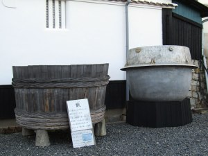 At Kamotsuru Brewery, an old rice steaming vat (right) and its wooden rice basket. This vat could hold three tons of rice and produce 4,000 bottles of sake.