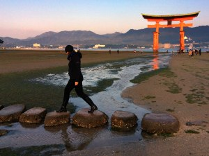 A series of large stones provide a crossing over the stream running through the Great Torii. This entire area will be covered in water in a few hours.
