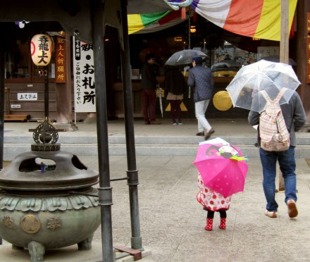 A young girl braving the rain at the Kawagoe Farmers Market at Renkeiji Temple