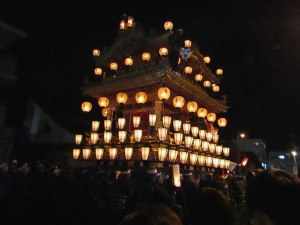 The massive yatai (ornate float) is pushed and pulled through the Nakamachi district
