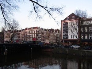 One of Amsterdam's many canals. The mural on the building caught our eye...