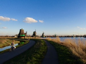 A bike path runs along the east side of the Zaan River, offering a convenient way to view the windmills.