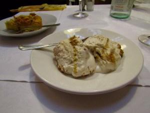 Dessert of almond cake and semifreddo al mascarpone, better known as tiramisu.