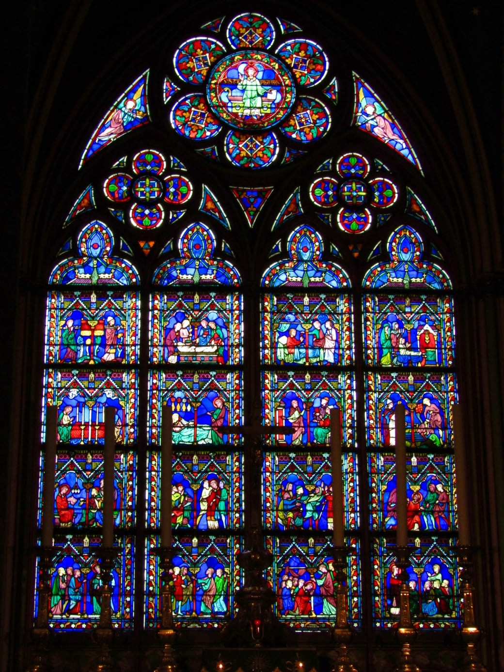 One of the many stained glass windows depicting various biblical scenes inside the cathedral at Notre-Dame.