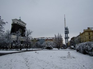 The Žižkov Television Tower at right, toned down by the Sacred Heart Church in Vinohrady.
