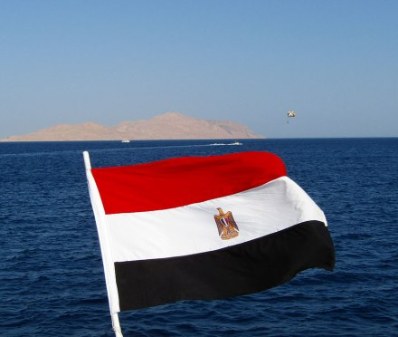 An Egyptian flag with Tiran Island in the distance.