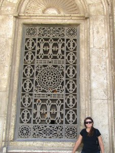 The limestone exterior and iron windows. The mosque is built in the Ottoman/Turk style.