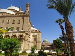 A peek of the green-domed Al-Nasir Muhammad Mosque behind Muhammad Ali.