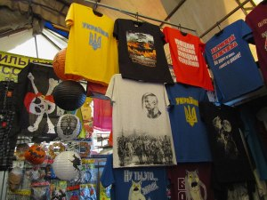 Souvenir t-shirts. The ones in yellow and blue say Ukraine and display the three-pronged crest.