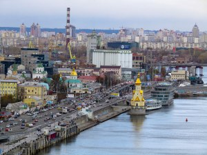 """This city landscape includes the golden St. Nicholas """"on the water"""" Church to the right."""