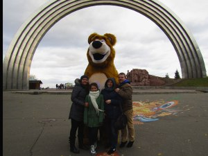 """My cousins and I with this """"Masha and the Bear"""" bear. It's funny because one of my cousins is named Masha."""
