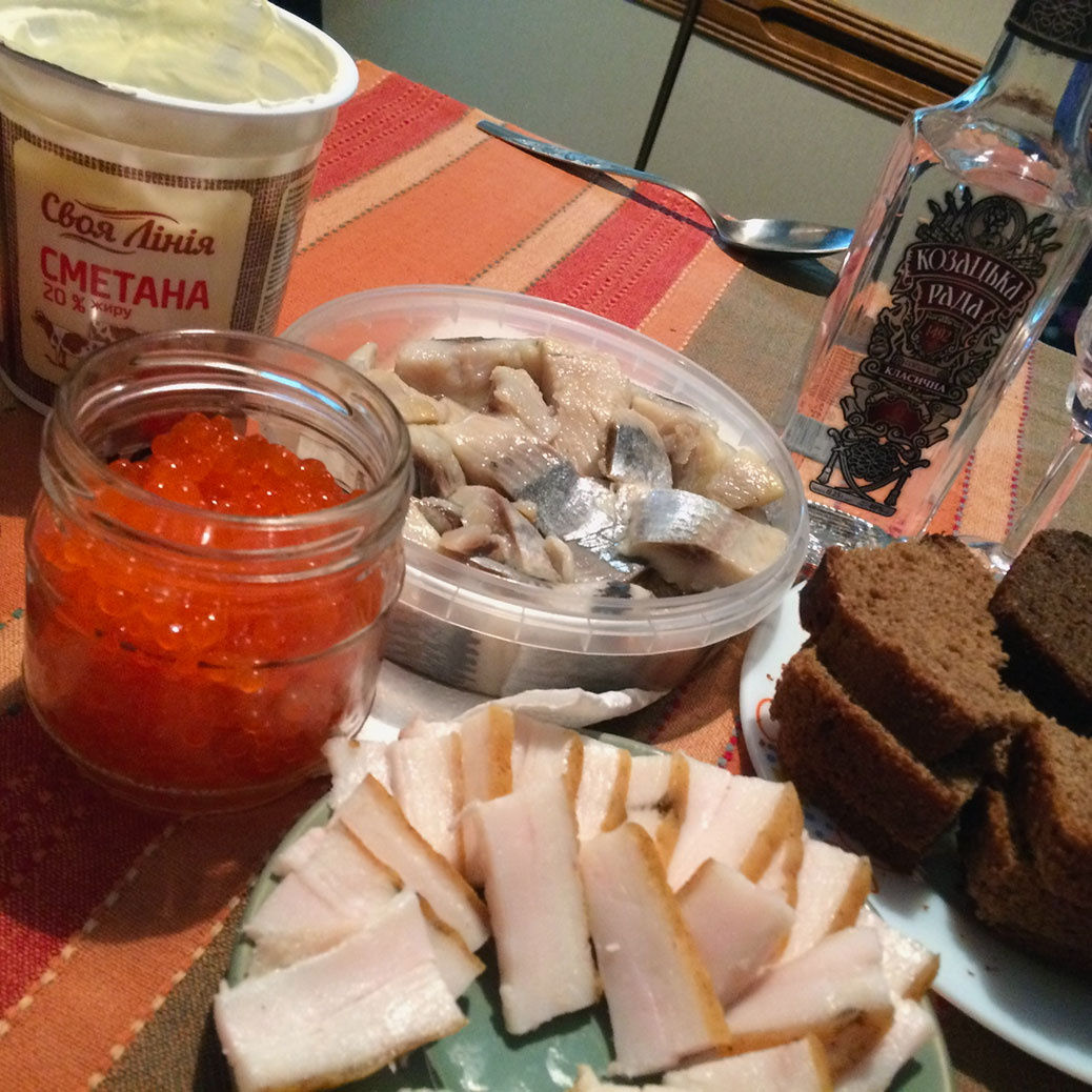 """Sour cream for the borscht soup, salted fish, vodka, bread, """"salo"""" pork fat, and roe."""
