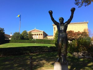 A statue of Rocky Balboa, cast for the movie Rocky III, stands in the shadow of the Philadelphia Art Museum. Several visitors ran up the steps, recreating the inspiring scene from the original Rocky movie.