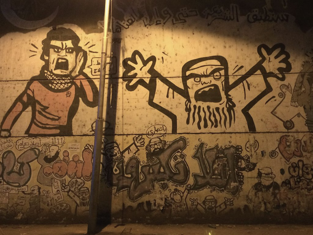 Graffiti from the 2013 protests depict the Muslim Brotherhood along Mohamed Mahmoud Street near Tahrir Square.