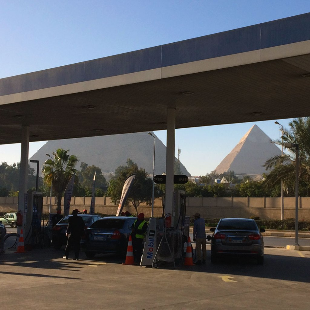 Our first up-close glimpse of the Pyramids came from a gas station... pretty good view while filling up the tank.