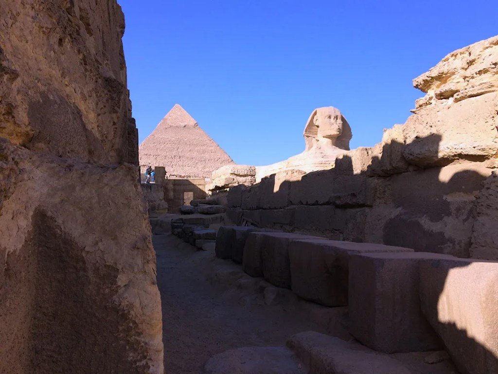Coming around a corner near the entrance of the Sphinx Temple, the Great Sphinx and Khafre's Pyramid peeked through the ruins.