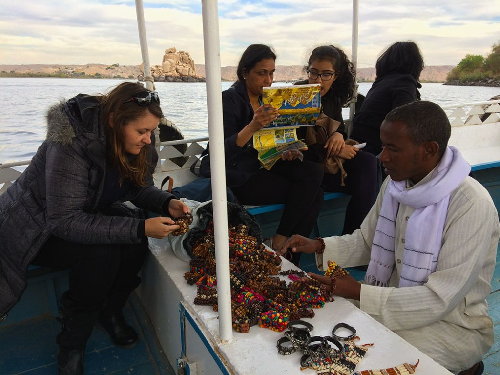 On our way to Agilika Island, the ferry boat captain brought out bracelets and other trinkets for sale.