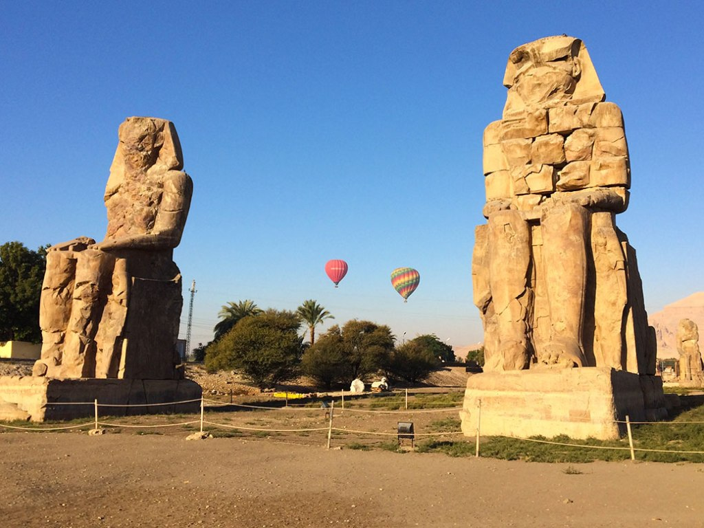 The twin statues of Pharaoh Amenhotep III known as the Colossi of Memnon in Luxor.