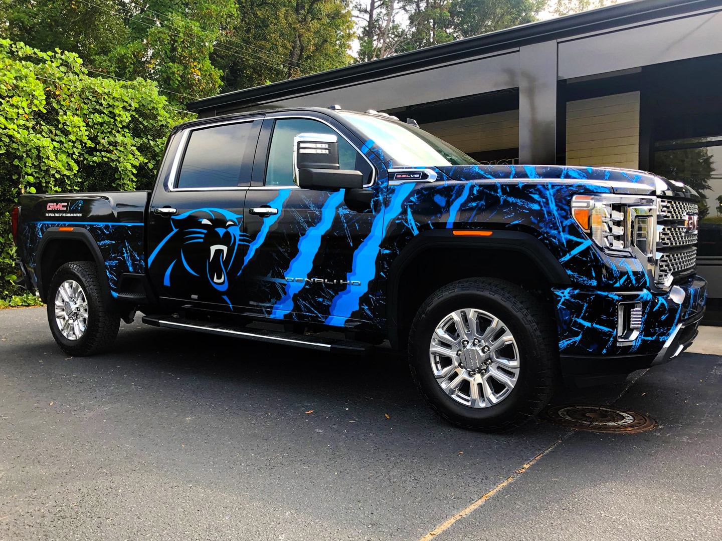 Pickup truck wrapped with sports graphics.