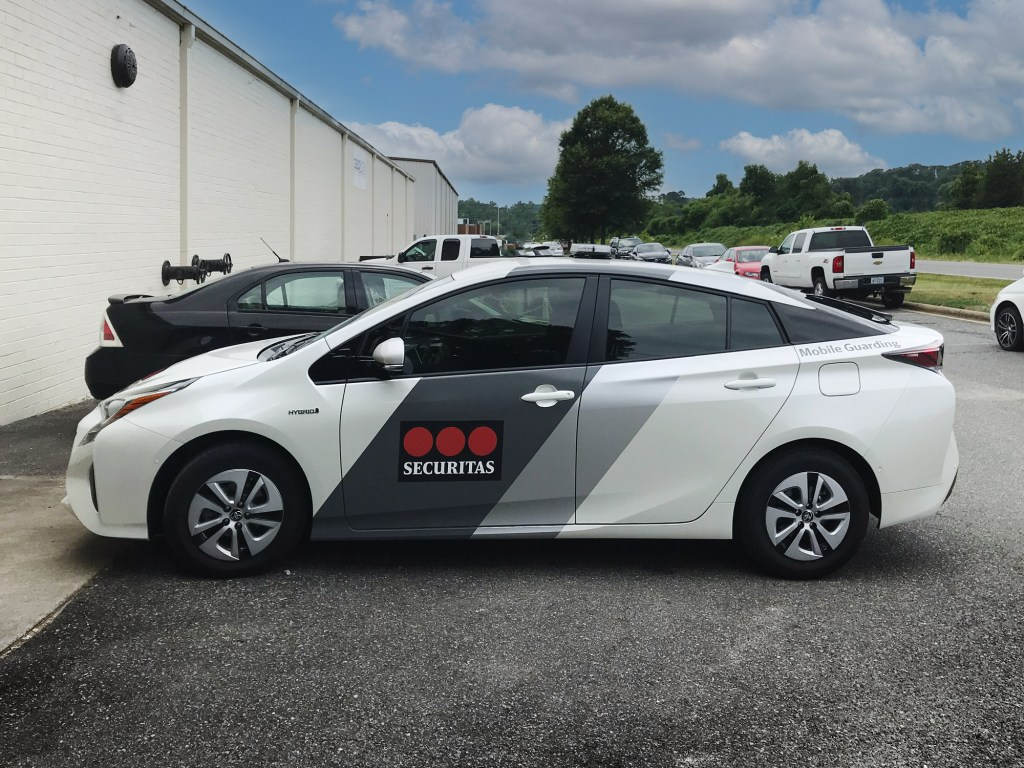 Toyota Prius with graphic wrap for a security service.