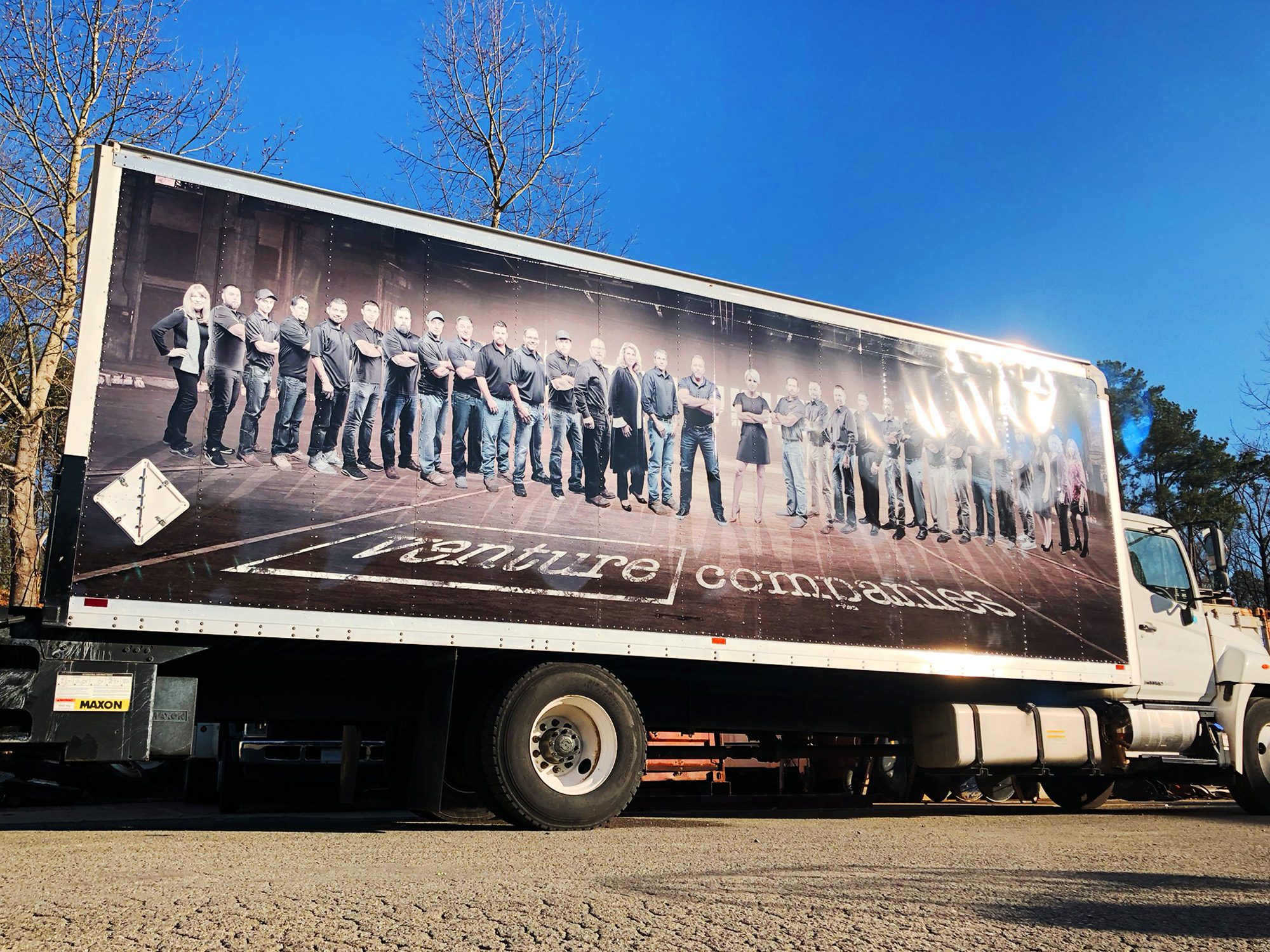 Large format photos on a trailer.