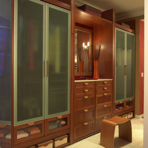 This Design By Closet Guru Lisa Adams Keeps Everything Tucked Away And  Protected. A Variety Of Clear, Opaque, And Solid Cabinet Fronts Create A  Unique Look ...