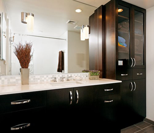 stylish cabinetry is another way to create a beautiful bathroom theres plenty of storage for towels linens body products and more with floor to ceiling