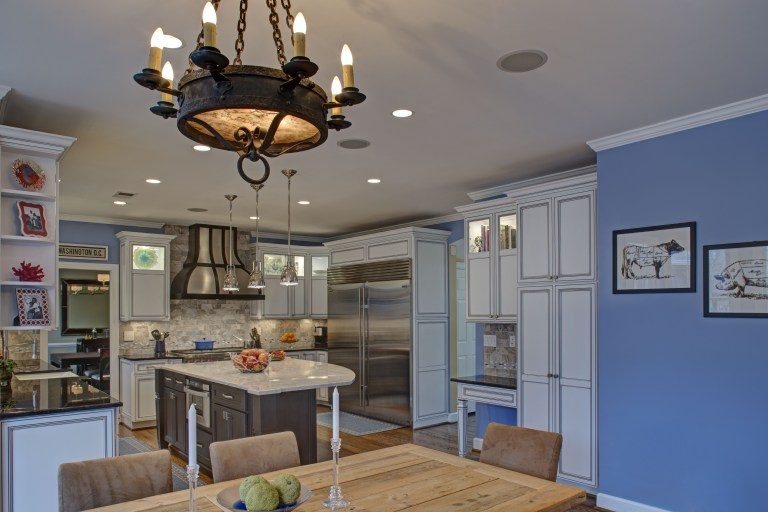view into renovated traditional kitchen from dining room extra large stainless steel refrigerator center island
